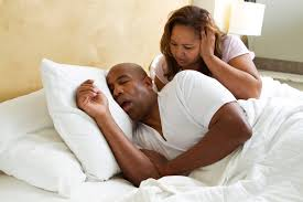 woman can't sleep, husband snoring