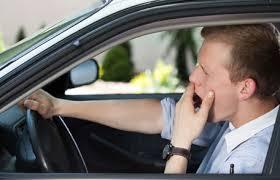 Man in car yawning