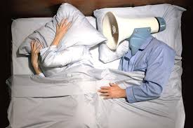 man in bed with megaphone for a head