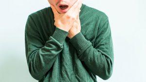 Man Holding Jaw