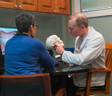 Dr Sheridan Holding a model Skull