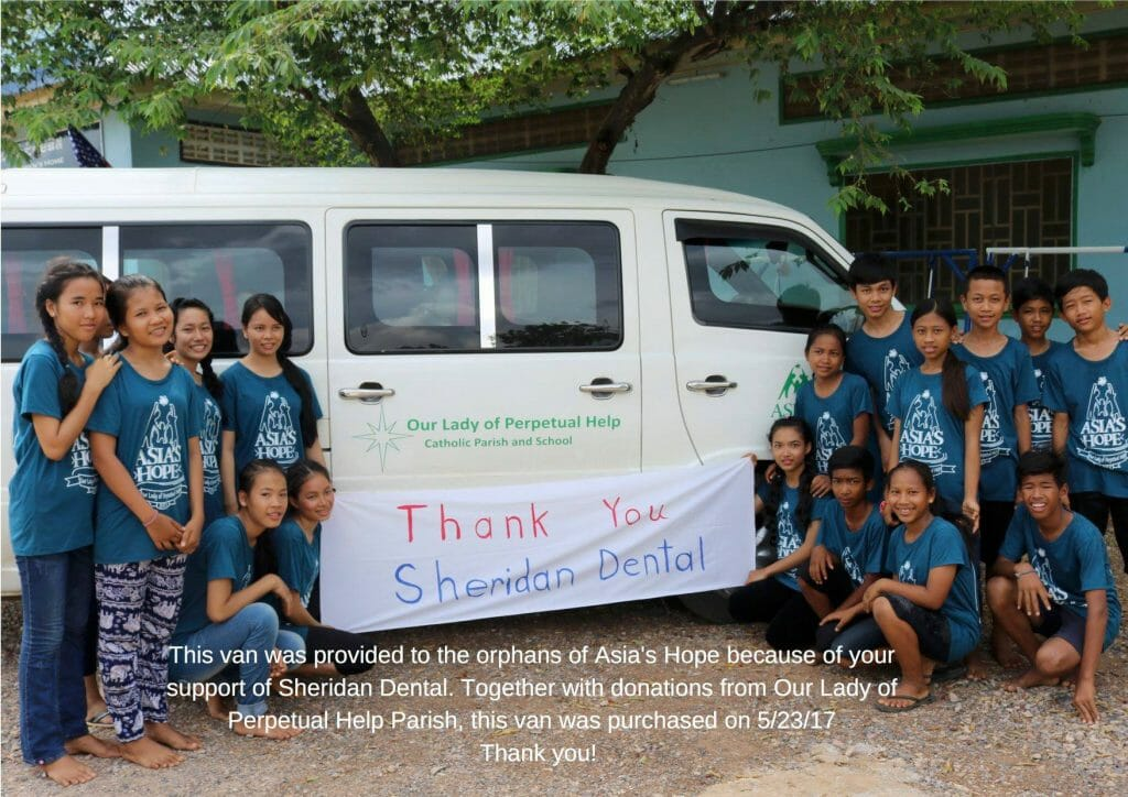 Orphans of Asia's Hope surrounding a van donated by Sheridan Dental team
